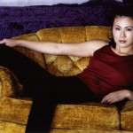 Photo of actress Joan Wong, sitting on a sofa
