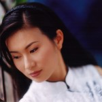 Photo of actress Joan Wong, wearing a traditional white Chinese outfit