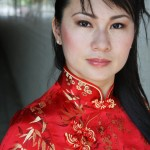Photo of actress Joan Wong, wearing a traditional red Chinese outfit